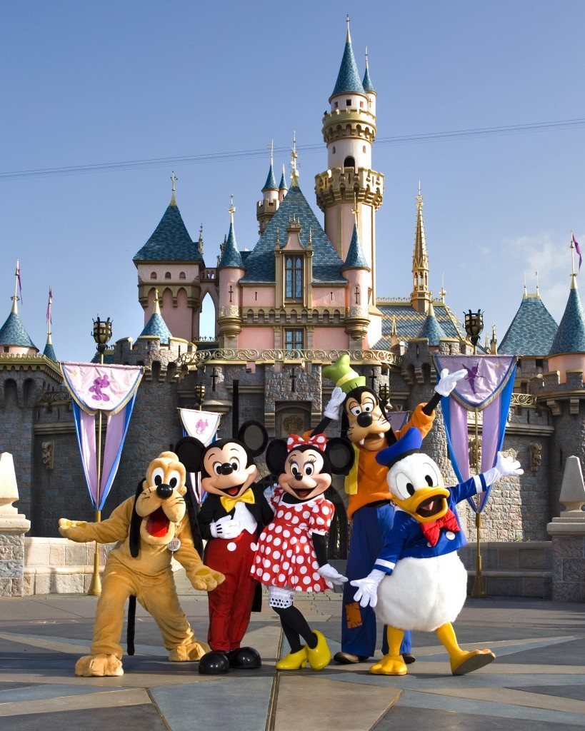 Mickey Mouse and his friends posing in front of Disneyland