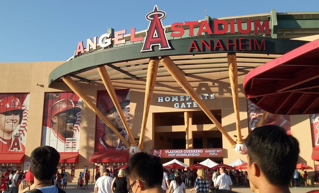 People entering the Angels Stadium, an arena in Los Angeles