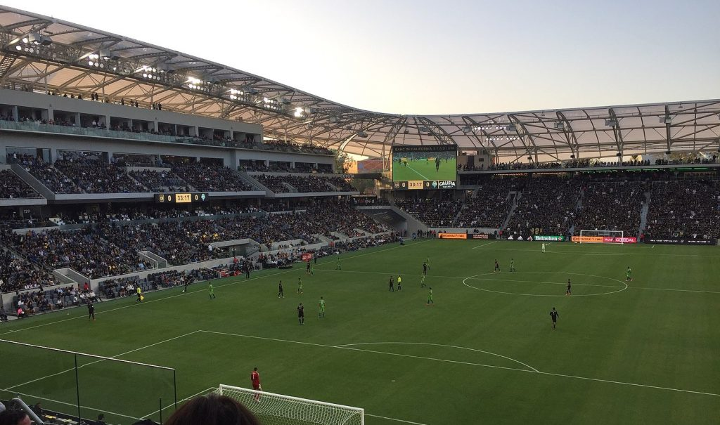 A game of soccer being played at Banc of California Stadium, an arena in Los Angeles