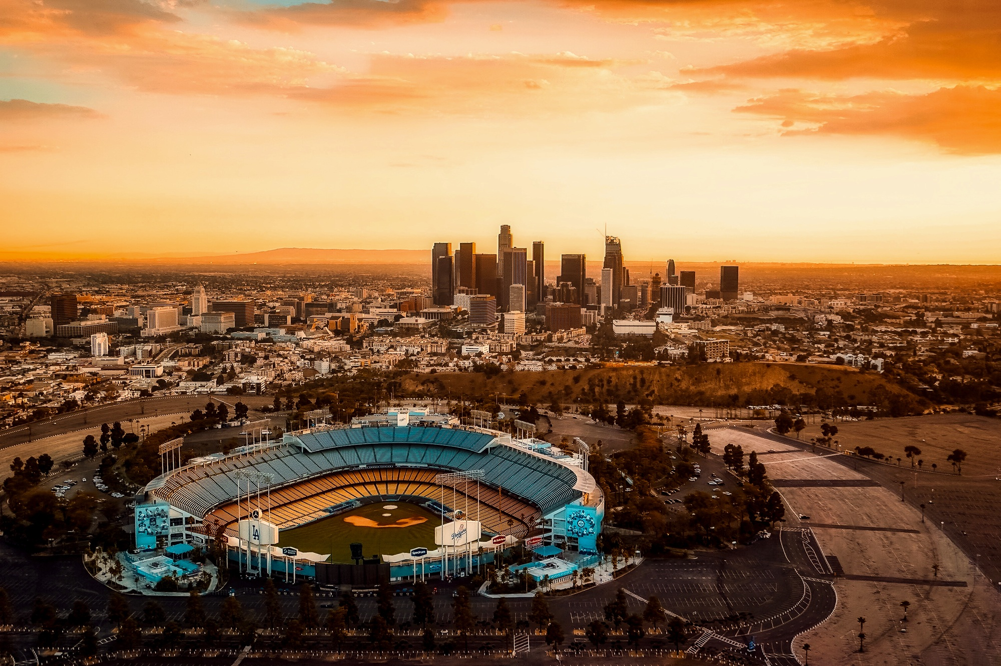 The sun setting over Dodger Stadium, an arena in Los Angeles