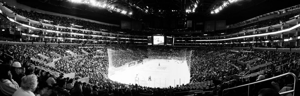 A black and white photo of the Staples Center, an arena in los angeles, during a game,